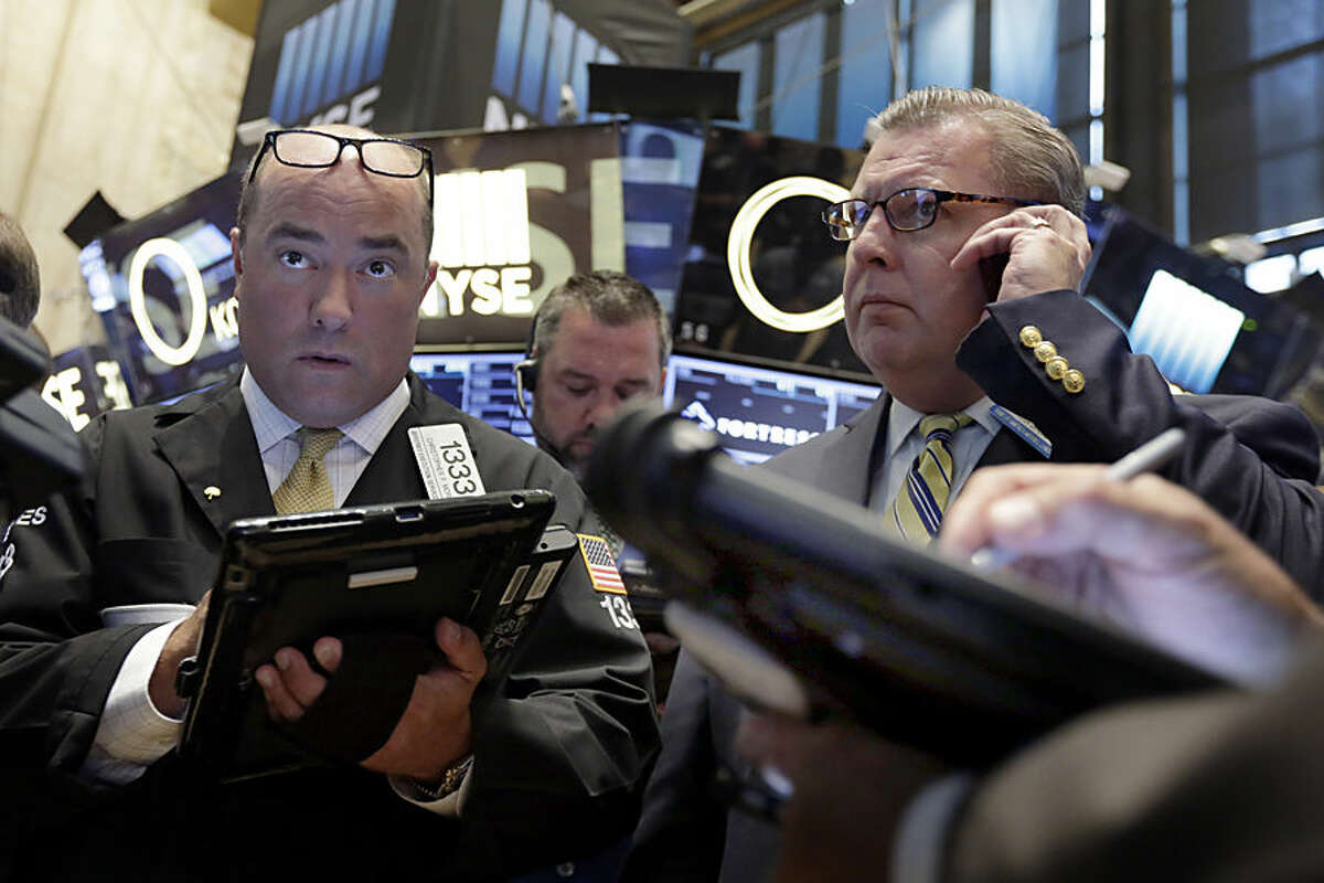 Traders work on the floor of the New York Stock Exchange, Tuesday, Aug. 18, 2015. U.S. stocks are lower in early trading after China's main index had its biggest fall since late July. (AP Photo/Richard Drew)