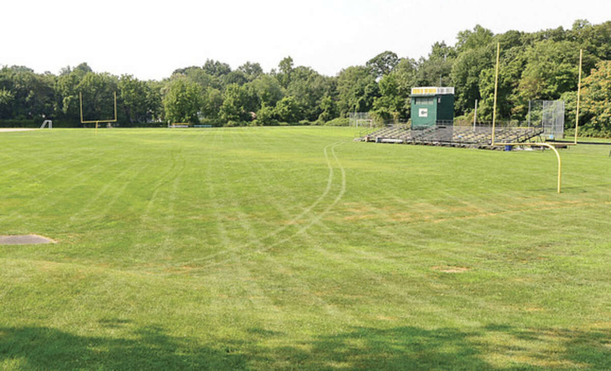 Photo by Erik Trautmann Trinity Catholic High School in Stamford was supposed to have a brand new multiple-purpose, artificial turf athletic field in place for this fall sports season but work has not started.