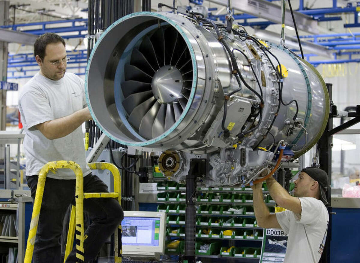 FILE -- In this Dec. 13, 2006 file photo, workers assemble a PW500 engine destined for a Cesna Citation at the Pratt & Whitney plant in Longueuil, Quebec, Canada. Sale of private jets, like the Citation, are rising again in 2014 after the deep recession when the company plane was an easy target for spending cuts. Pratt & Whitney Canada laid off more than 400 workers in 2009 and 2010. But company president Paul Adams said in May 2014 that improvements in the top part of the business have driven the market?•s recovery, (AP Photo/The Canadian Press, Paul Chiasson, File)