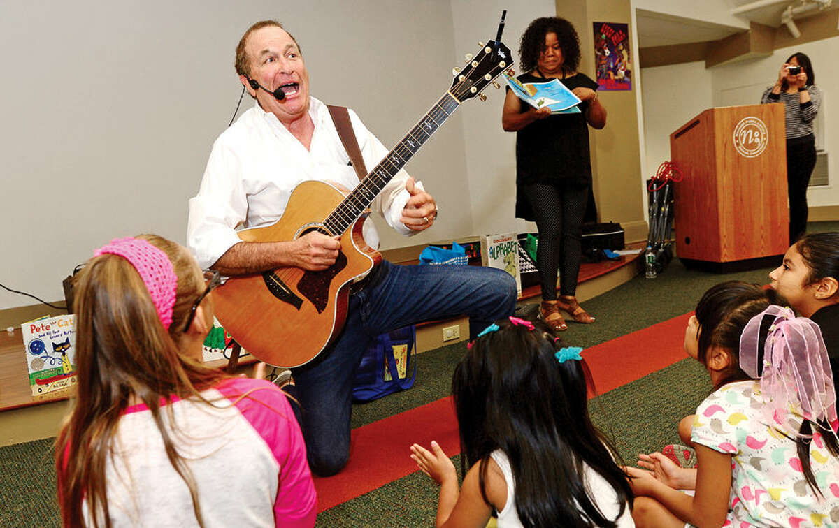 """Hour photo / Erik Trautmann Al deCant's performs his """"Rockin' and Reading with Pete the Cat"""" during the Back to School Celebration for children in grades K - 5 at the SoNo Library Saturday sponsored by the library and ConnCAN (The Connecticut Coalition for Achievement Now)."""