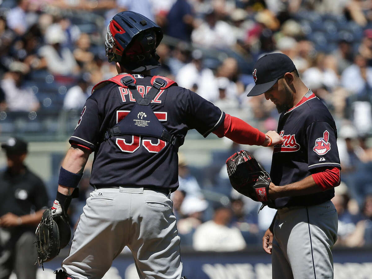 Cleveland Indians catcher Roberto Perez (55) encourages pitcher Danny Salazar after Salazar gave up a second home run to the New York Yankees during the first inning of a baseball game, Saturday, Aug. 22, 2015, in New York. (AP Photo/Julie Jacobson)