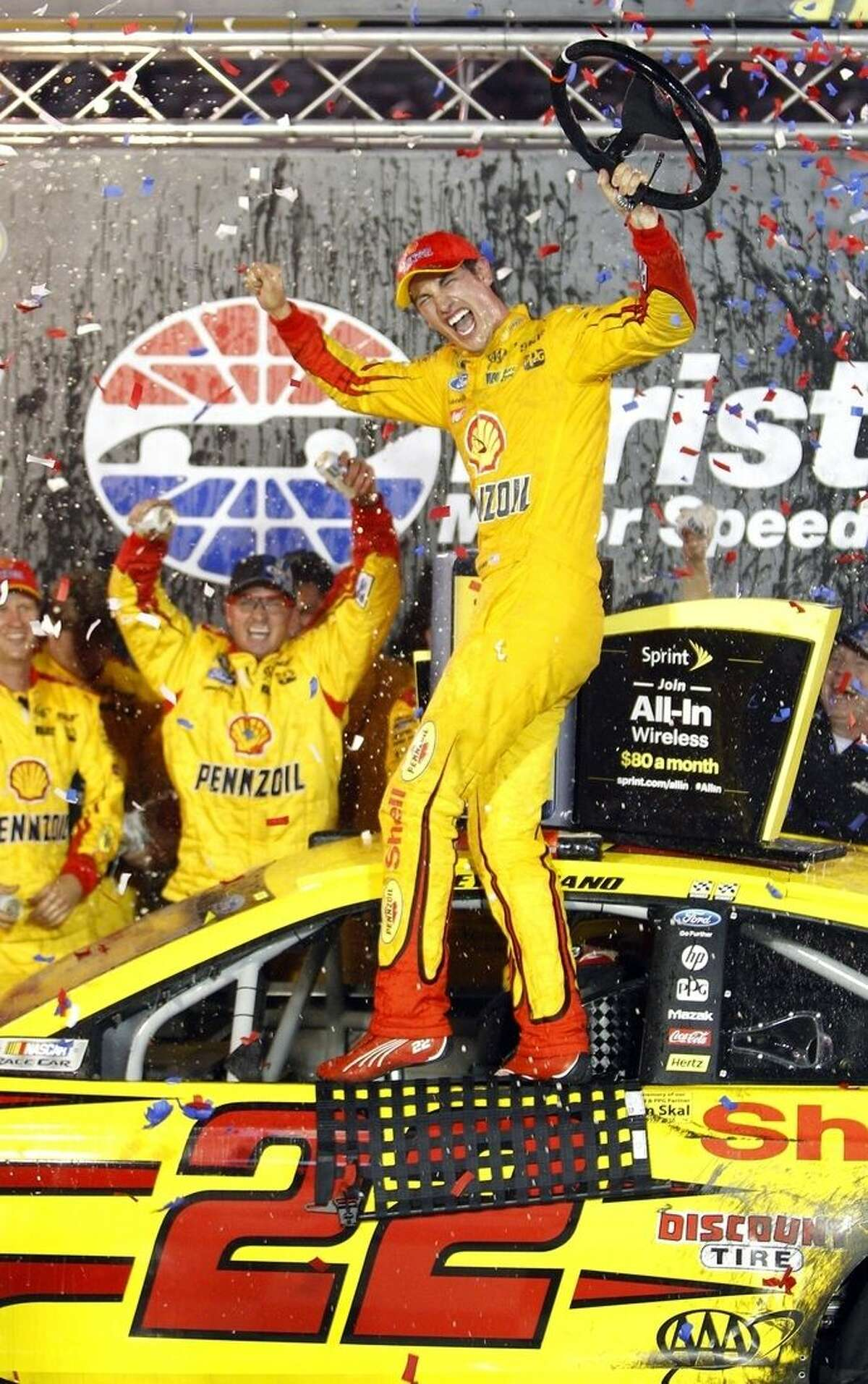 Joey Logano celabrates in Victory Lane after winning the NASCAR Sprint Cup Series auto race, Saturday, Aug. 22, 2015, in Bristol, Tenn. (AP Photo/Wade Payne)
