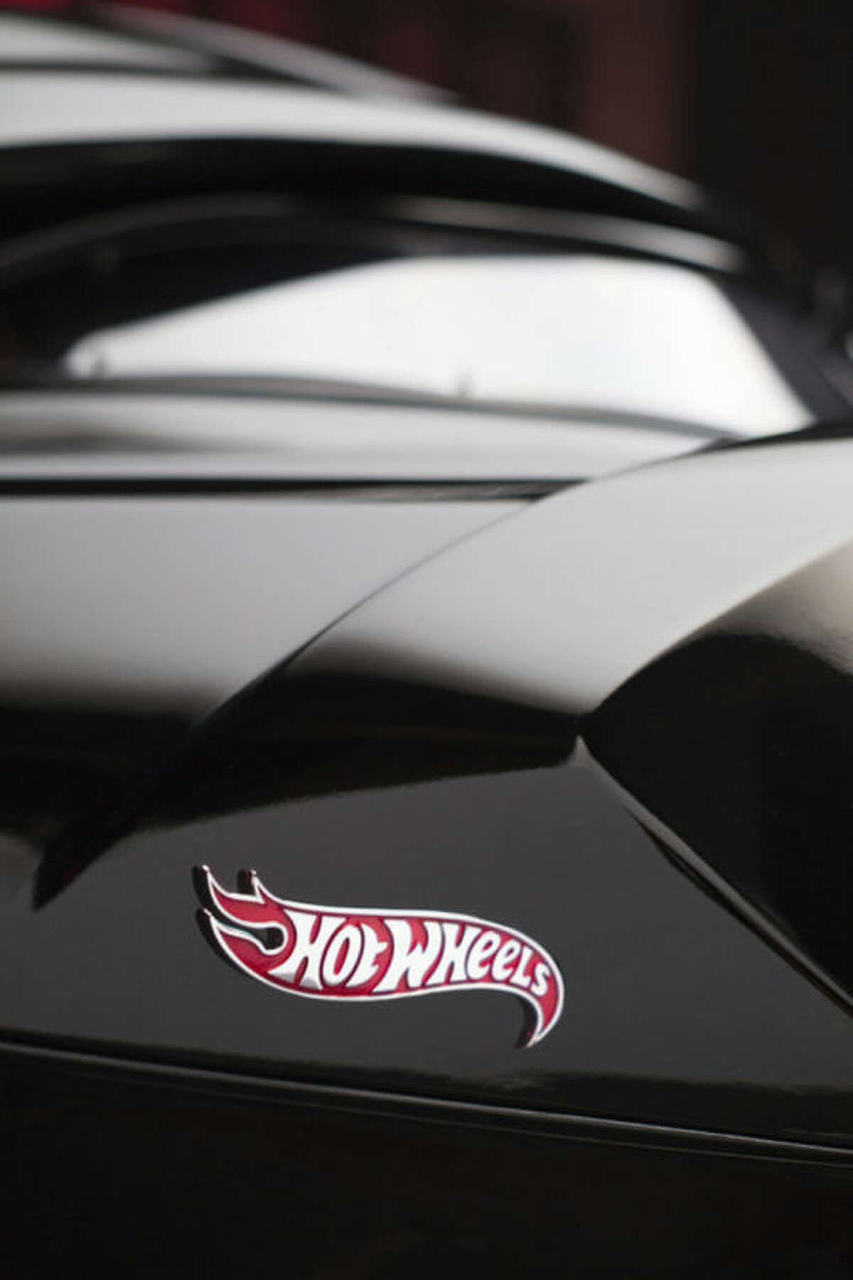"""This photo provided by courtesy of Mattel, Inc. shows a detail of the """"Hot Wheels Life-Sized Darth Vader Car."""" When it comes to designing the highly coveted collectible toys for sale at Comic-Con, the annual celebration of pop culture lifting off Thursday, July 24, 2014, in San Diego, the sky's the limit for the designers at Mattel. Fittingly, the building where Mattel's dreamers conceive of their limited-edition playthings is just down the street from the Los Angeles International Airport. (AP Photo/Mattel, Inc., JeffreyMoustache)"""