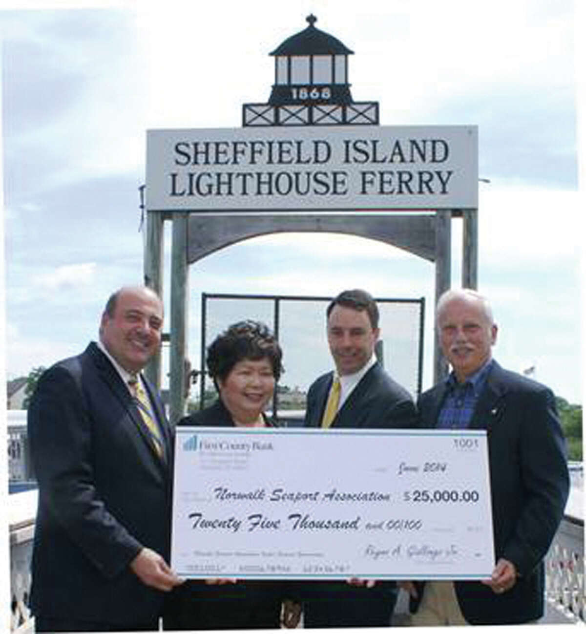 From left to right: Robert Granata, president and COO of First County Bank, Irene Dixon, president of the board of trustees of the Norwalk Seaport Association, Inc., Mike Reilly, Oyster Festival chairman/trustee and Rey Giallongo, chairman and CEO of First County Bank. As the presenting sponsor, First County Bank presents its sponsorship check to the Norwalk Seaport Association for the 2014 Oyster Festival.