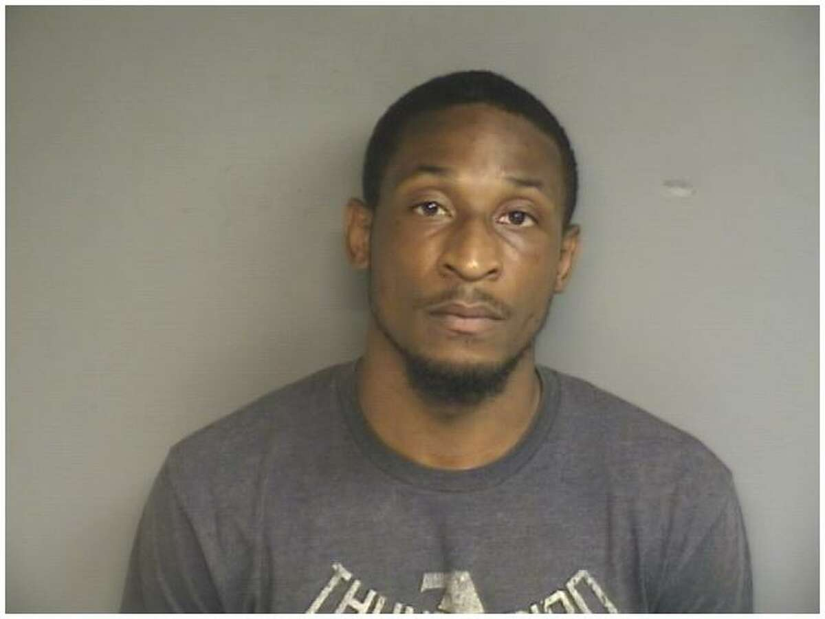 This photo provided by the Stamford Police Department shows 25-year-old Everton Kinlock, who is accused of breaking into his ex-girlfriend's Cove Road home and smashing her belongings.