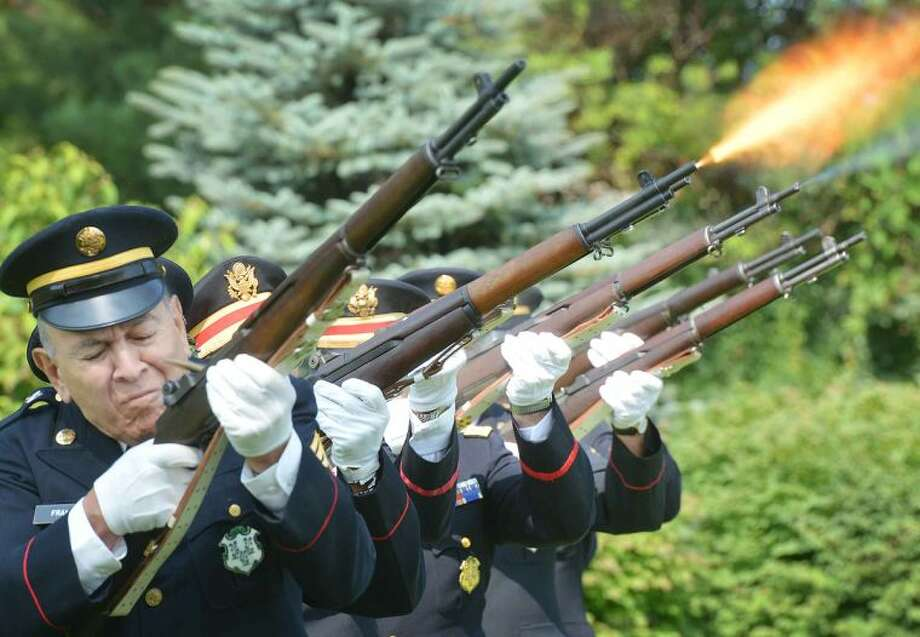 Hour Photo/Alex von Kleydorff The 1st Company Governors Footguard fires a 21 gun salute to start the 5th Annual Housing For Heroes Connecticut Golf Classic at Shorehaven Country Club on Monday.