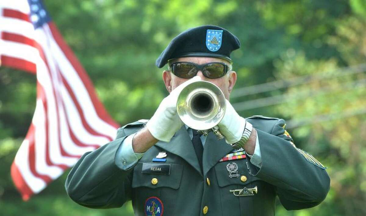 Hour Photo/Alex von Kleydorff The 1st Company Governors Footguard Trumpeter Harvey Redak, U.S. Army, Ret. plays The National Anthem for the 5th Annual Housing for Heroes Connecticut Golf Classic