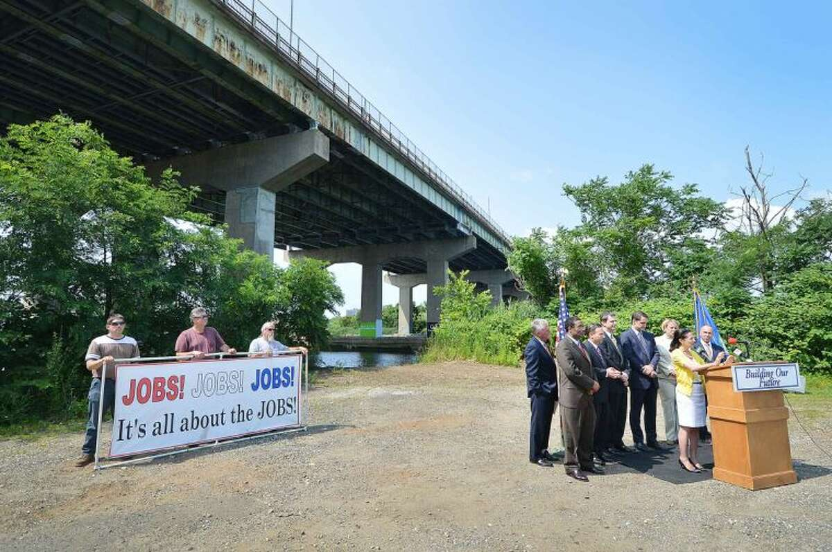 Hour Photo/Alex von Kleydorff Congressman Jim Himes joins local elected officials, transportation experts and labor leaders at I95's Yankee Doodle Bridge, a structurally deficient bridge in Norwalk to highlight the urgent need for long-term investments in federal transportation infrastructure.