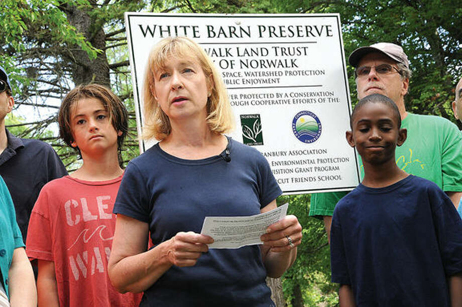 In this file photo, Joann Jackson with the Norwalk Landtrust speaks Saturday at the press conference and cleanup of the White Barn Preserve along with members of The Westport RTM and Save Westport Now on Saturday. Hour photo/Matthew Vinci
