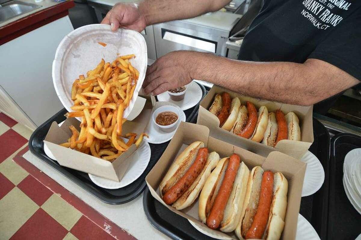 Hour Photo/Alex von Kleydorff Hot Dogs and Fries at Swanky Franks in Norwalk