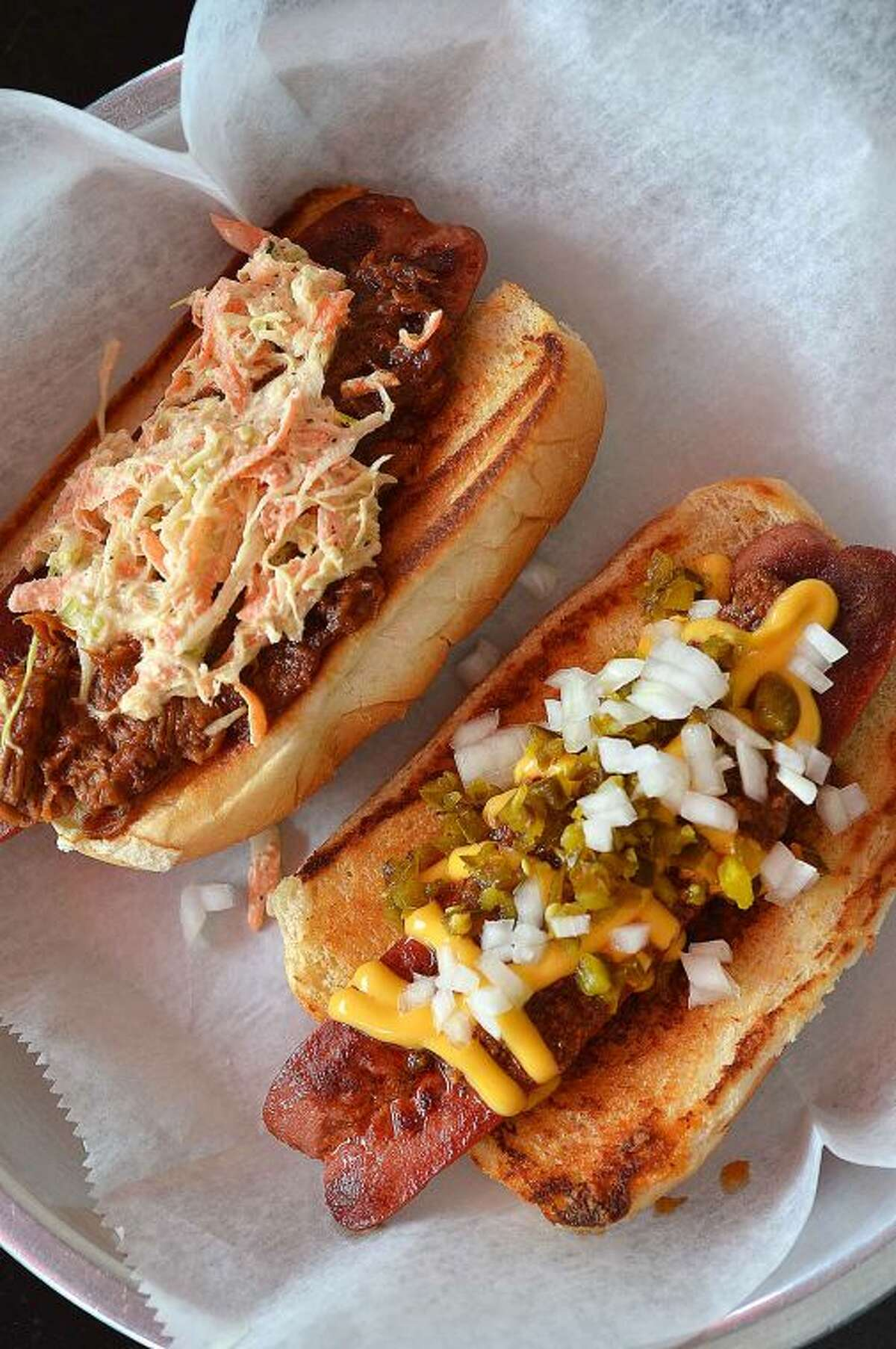 Hour Photo/Alex von Kleydorff From Bridge Street Wienery in Stamford two of the popular dogs are, The Squeeler, BBQ Pulled Pork and Coleslaw and the Lil-Lo Dog with Home made Chili, Chopped Onions and jalapenos and Cheese Sauce.