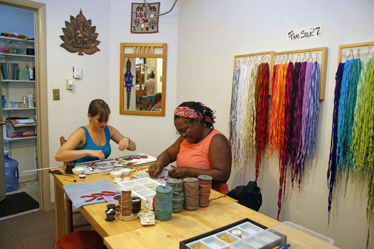 Alessandra Sena teaches Carmeta Moaze how to make a necklace using leather, wire, and recycled Sari silk during a Leather and Textile Workshop at Beadworks in Norwalk Sunday afternoon. Hour Photo / Danielle Calloway