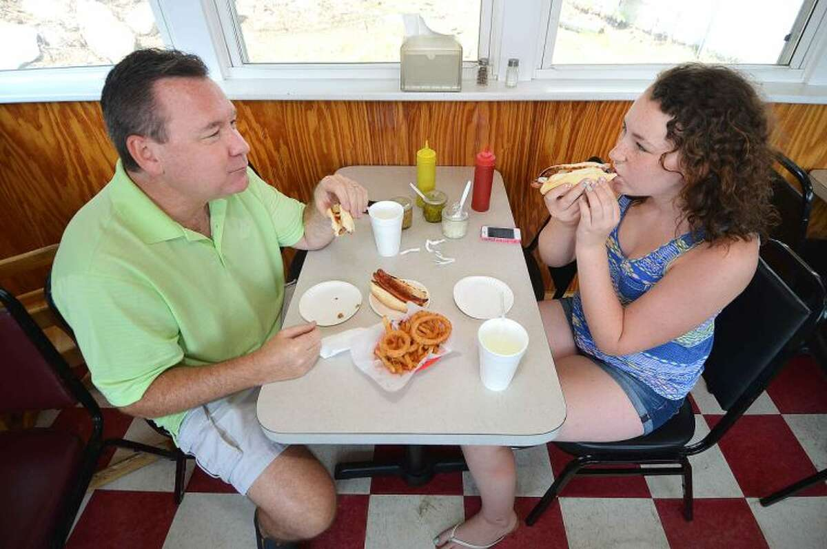 Hour Photo/Alex von Kleydorff Wilton's Mike LeBeau enjoys hot dogs for lunch with his daughter Macy at Swanky Franks in Norwalk