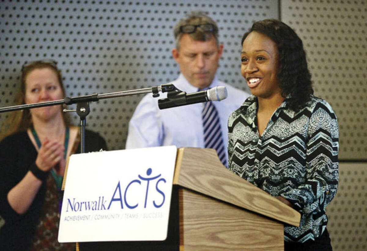 """Hour photo / Erik Trautmann """"I Have a Dream"""" scholar Jasmine Pressie reads the opening of the """"Memorandum of Understanding"""" before Norwalk ACTS members sign an agreement to ensure a coordinated and integrated coalition of resources to dramatically improve educational, social and emotional growth and physical health outcomes for Norwalk's children during a press event following ACTS' monthly meeting Tuesday."""