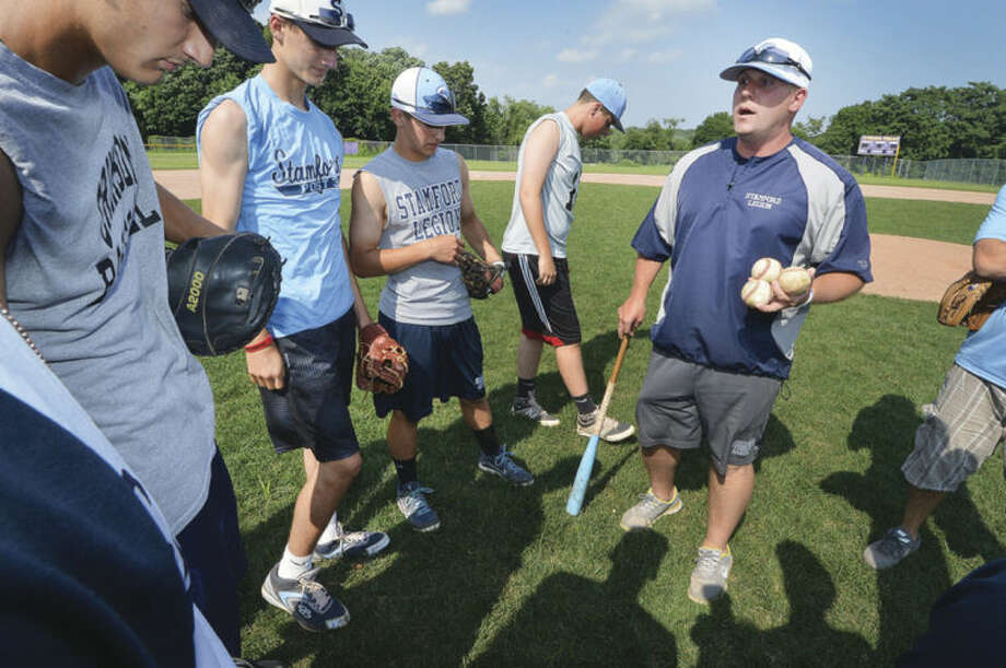 Hour Photo/Alex von KleydorffStamford American Legion coach Kevin Murray talks to players during practice at Westhill High School Tuesday.