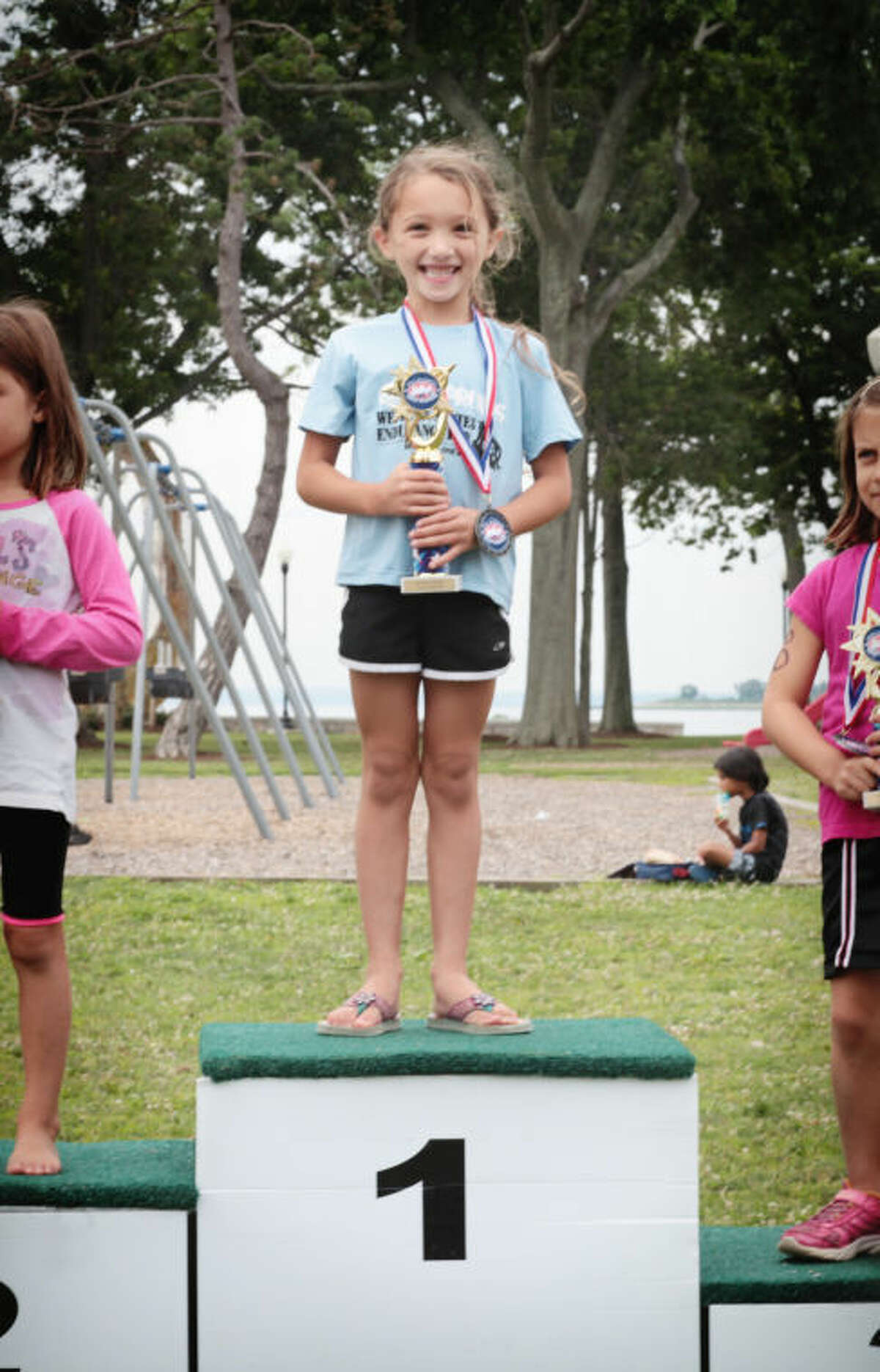 Contributed photo 6-year-old Paige Whipple of Norwalk, took part in the Mini Mossman Youth Triathlon Sunday at Calf Pasture Beach. Paige took 1st place girl in the 4-6 year old category.