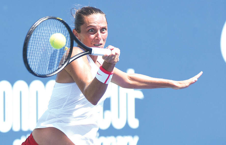 Hour photo/John Nash - Italy's Roberta Vinci puts some intensity into this forehand during her straight sets victory over Canada's Eugenie Bouchard in the first round of the Connecticut Open on Monday afternoon.