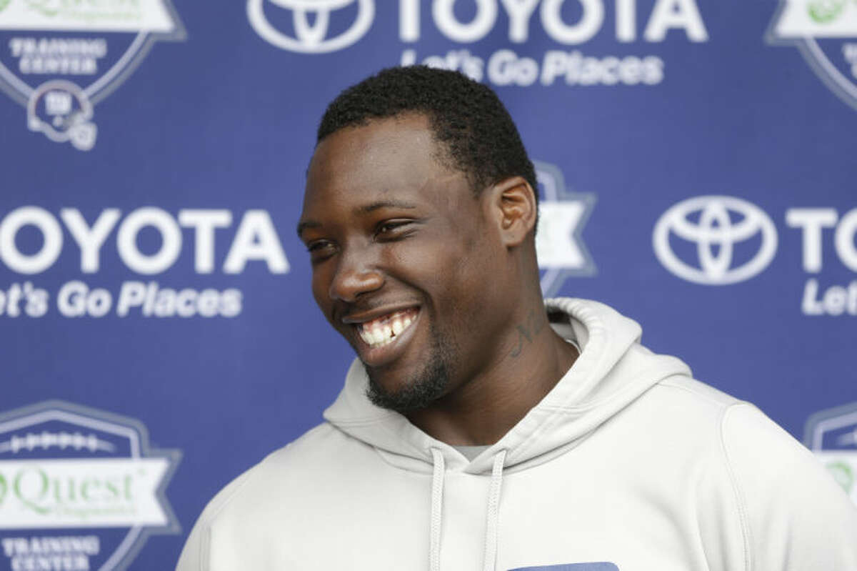 FILE - In this July 24, 2014, file photo, New York Giants' Jason Pierre-Paul talks to reporters during an NFL football camp in East Rutherford, N.J. Pierre-Paul has rapid-fire answers for just about anything he is asked, from the state of the New York Giants' defensive line to his own health to some missing teammates. (AP Photo/Seth Wenig, File)