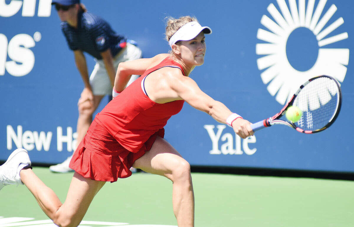 Hour photo/John Nash - Eugenie Bouchard of Canada extends for a backhand return during her first round match against Roberta Vinci at the Connecticut Open on Monday. Vinci crushed Bouchard 6-1, 6-0 to advance to the second round.