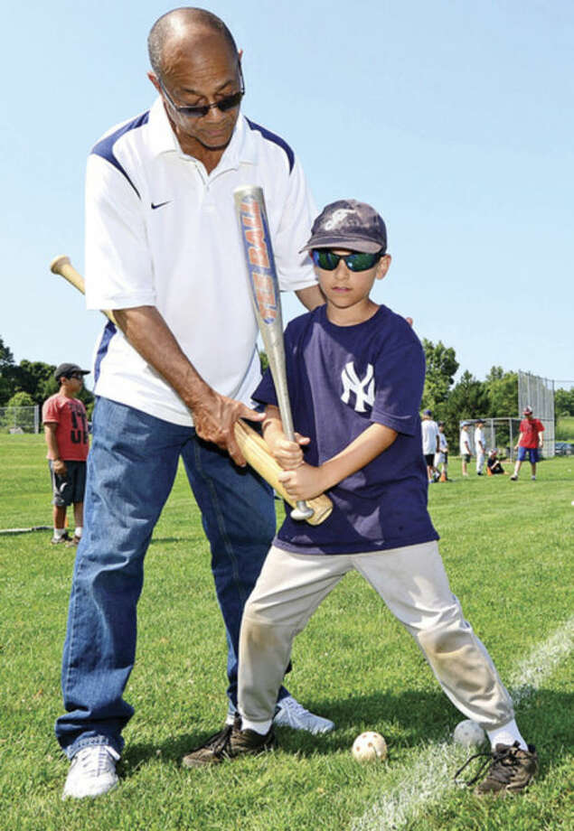 Hour photo / Erik TrautmannRoy White, formerly of the New York Yankees, teaches campers including Jack Basbalg how to play baseball during the Baseball World summer camp at Wakeman Field in Westport Friday.