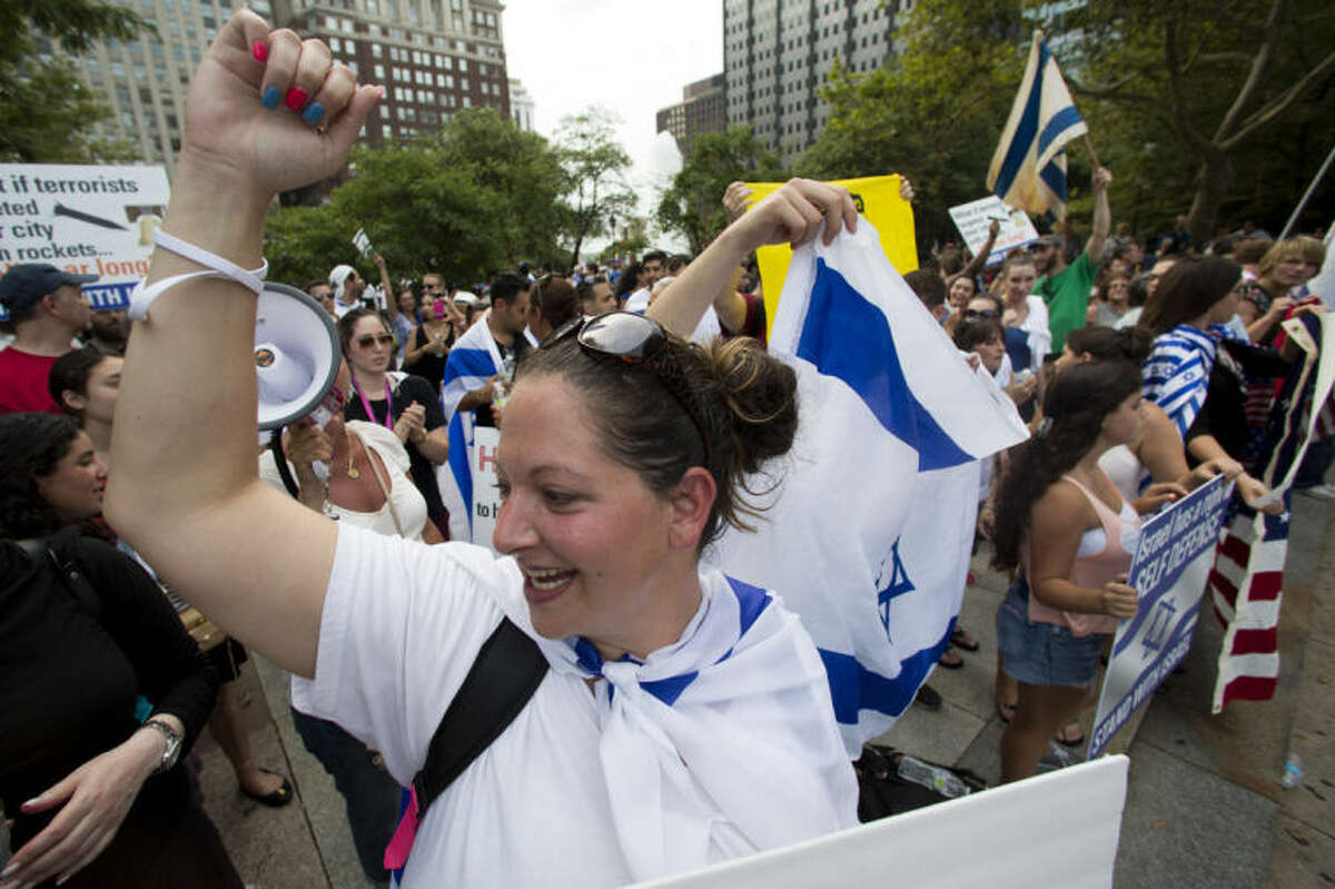 Demonstrators gather in support of Israel in its war with Hamas members in the Gaza Strip during a rally at John F. Kennedy Plaza, also known as Love Park, in Philadelphia on Wednesday, July 23, 2014. (AP Photo)
