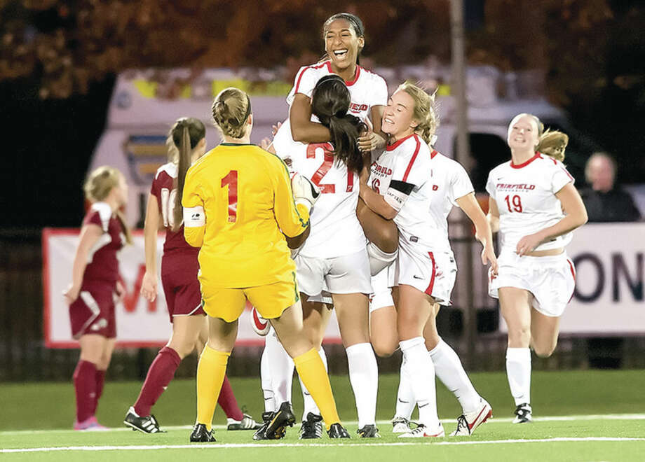 Photo courtesy of Fairfield UniversityNorwalk resident Karolyn Collins, a redshirt junior at Fairfield University, leaping high into the arms of teammates last season, was named co-captain of the Stags women's soccer team this summer.