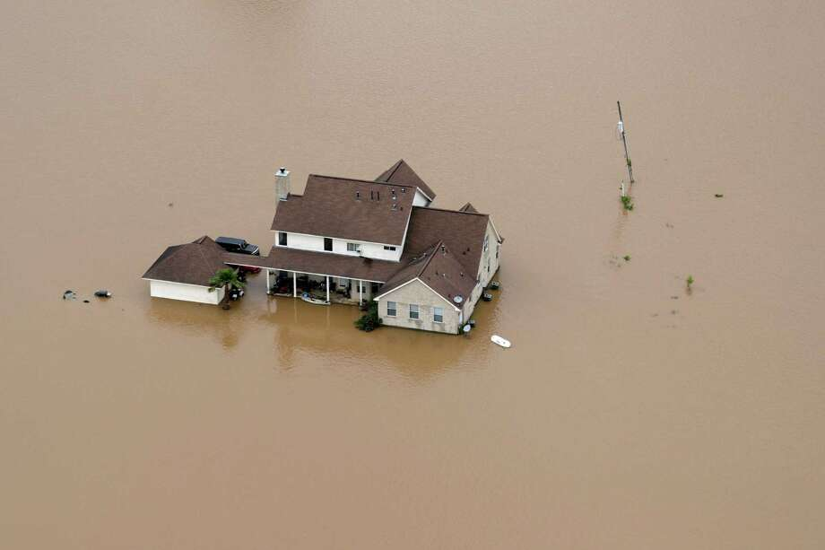 A Rosharon home is surrounded by floodwaters earlier this month. Since May 26, some parts of Southeast Texas have seen up to 20 inches of rain. Typically the region gets 40 to 50 inches of rain a year. Photo: David J. Phillip, STF / Copyright 2016 The Associated Press. All rights reserved. This material may not be published, broadcast, rewritten or redistribu