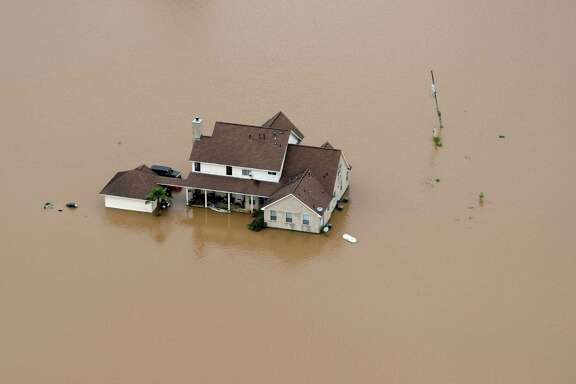 A Rosharon home is surrounded by floodwaters earlier this month. Since May 26, some parts of Southeast Texas have seen up to 20 inches of rain. Typically the region gets 40 to 50 inches of rain a year.