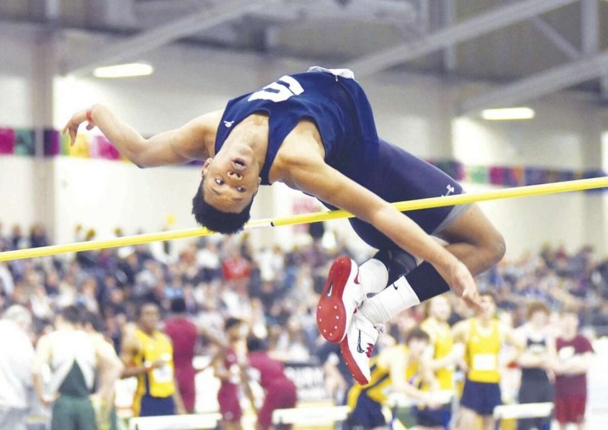 Hour photo/John Nash Staples High School's Anthony Bravo won the New England High Jump championship with a school record leap of 6 feet, 9 inches on Friday night at the Reggie Lewis Athletic Center in Boston.