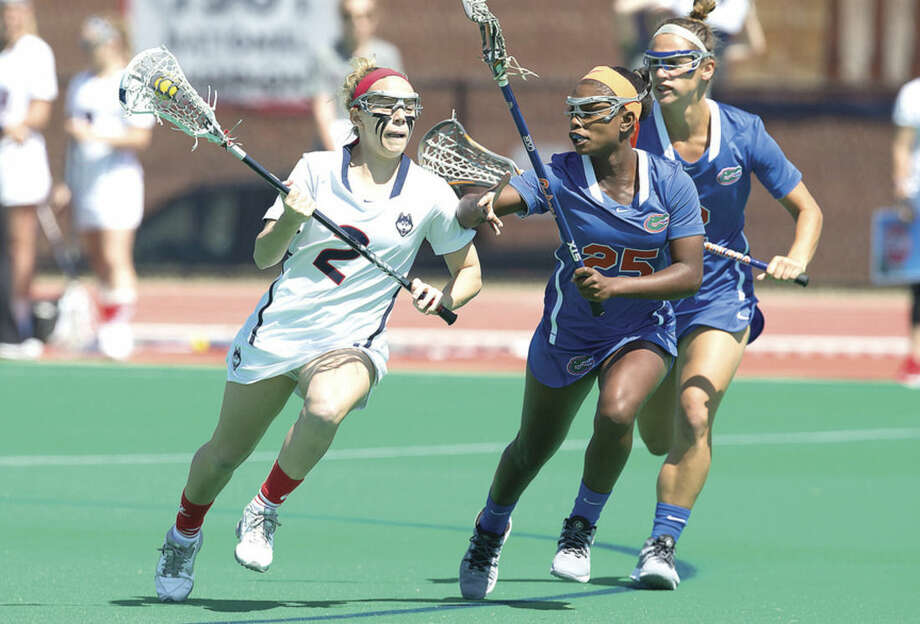 Photo courtesy of Steve Slade/UConn AthleticsAli Crofts, left, of the UConn women's lacrosse team might be the smallest player on the field when she plays, but she's come up big for the Huskies during her recently completed junior season.