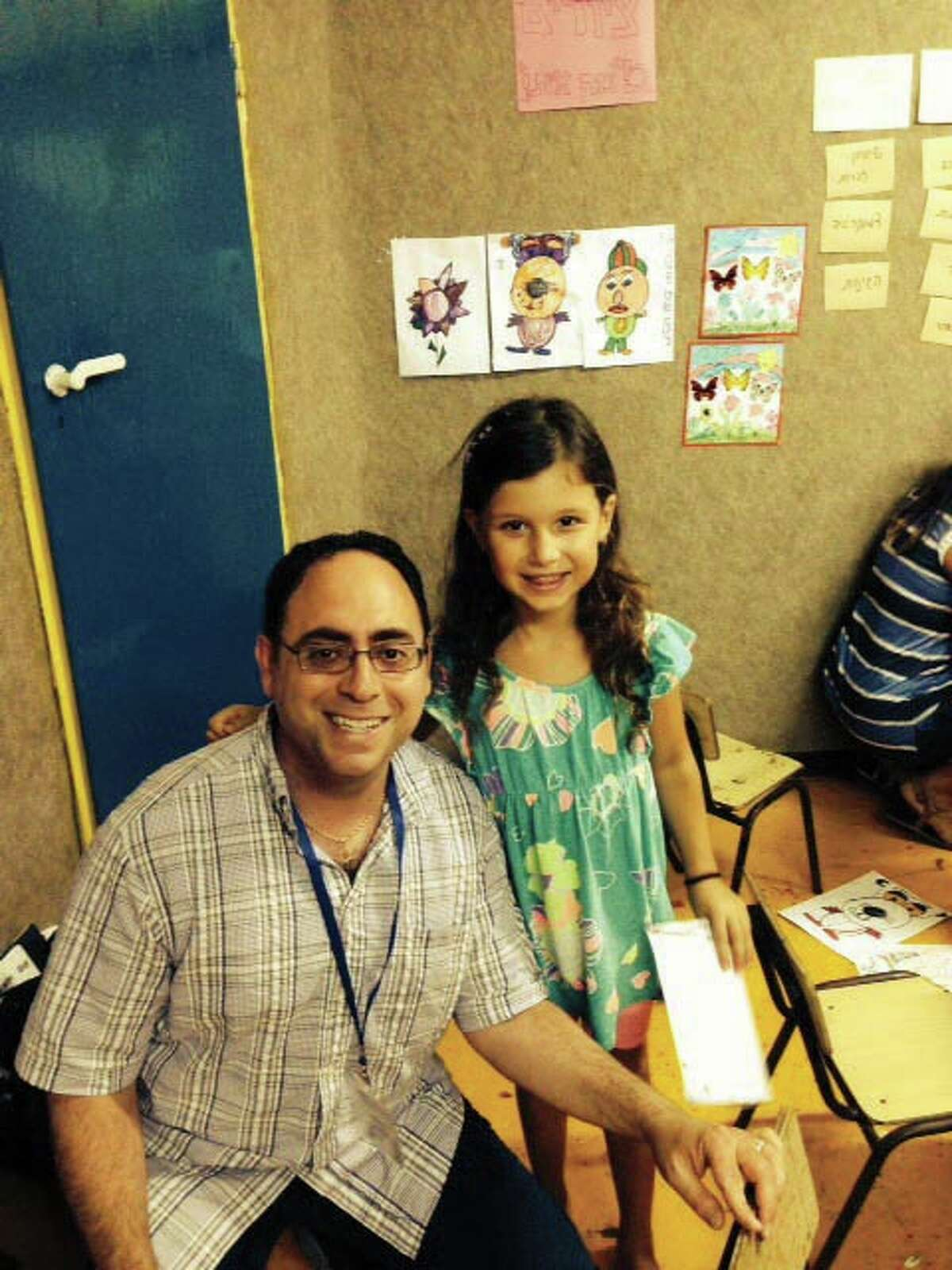 Contributed photo Rabbi Jeremy Wiederhorn with a child from Ashkelon whose summer camp was moved to a bomb shelter.