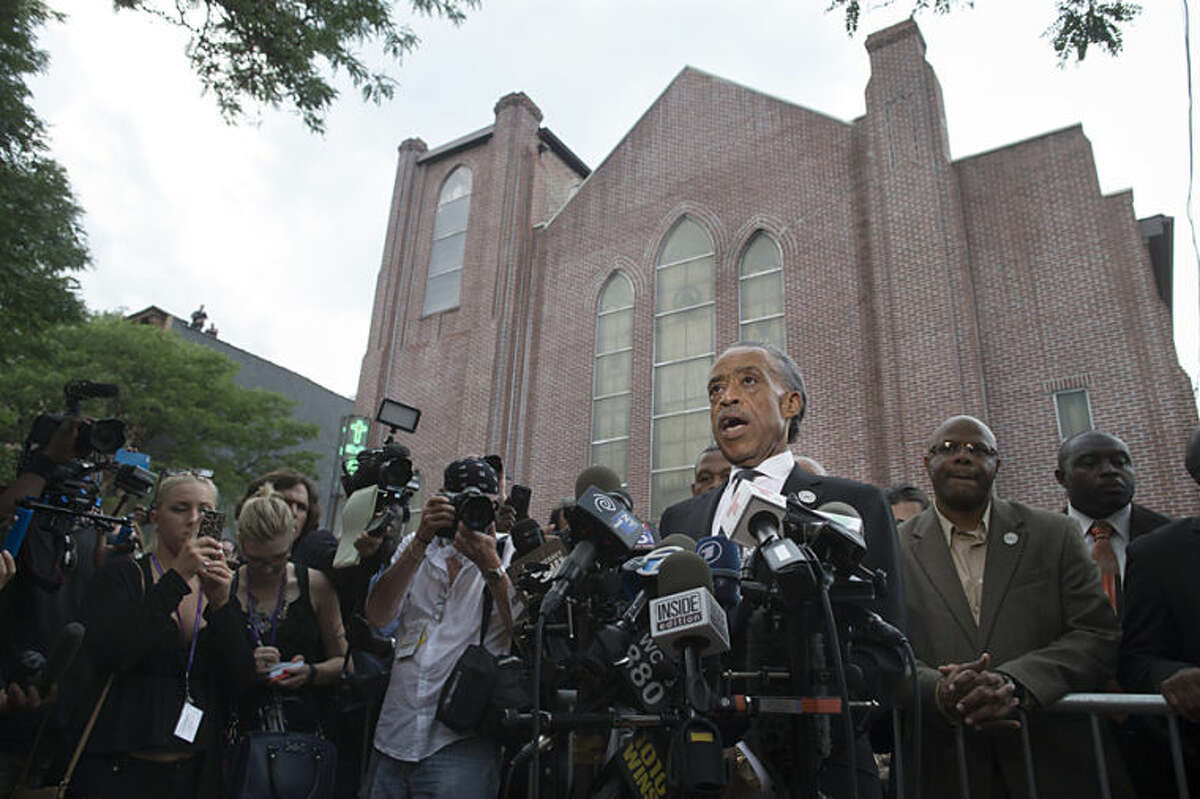 The Rev. Al Sharpton speaks to the media outside the funeral service of Eric Garner, the 43-year-old New York City man whose death while in police custody has led to accusations of police misconduct, at Bethel Baptist Church, Wednesday, July 23, 2014, in the Brooklyn borough of New York. (AP Photo/John Minchillo)