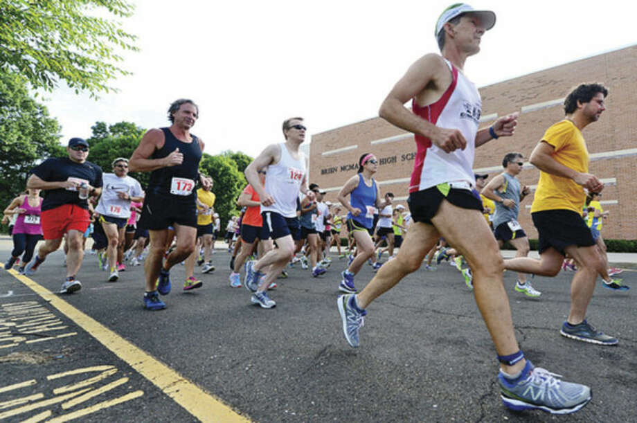 Hour photo/Erik TrautmannRunners start out in the Lightfoot Road Runners road race, a 7-miler at Brien McMahon High School in Norwalk on Saturday. Two high school students, Eric van der Els of Brien McMahon and Anne Johnston of Darien, won the race.