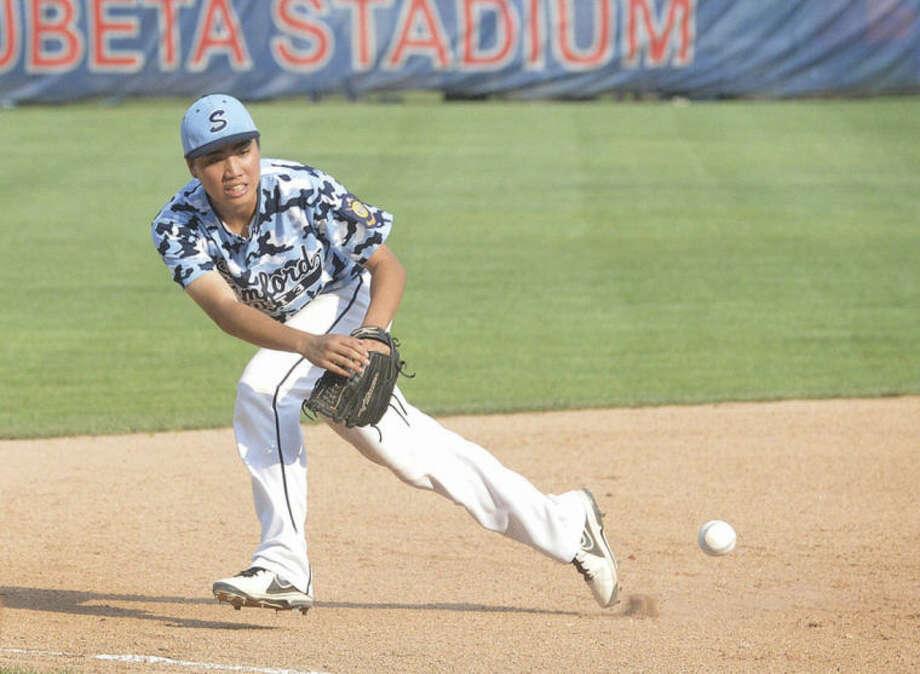 Hour Photo/Alex von KleydorffStamford's Tyan Lee tracks down a ground ball at third base Wednesday against Middletown.