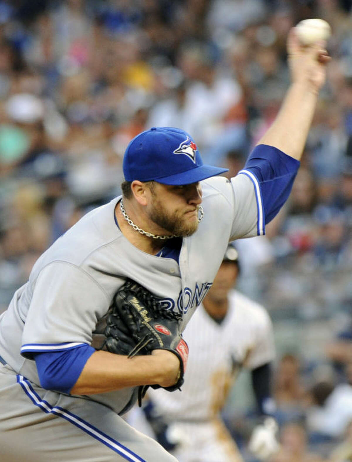 Toronto Blue Jays pitcher Mark Buehrle delivers the ball to the New York Yankees during the first inning of a baseball game Friday, July 25, 2014, at Yankee Stadium in New York. (AP Photo/Bill Kostroun)