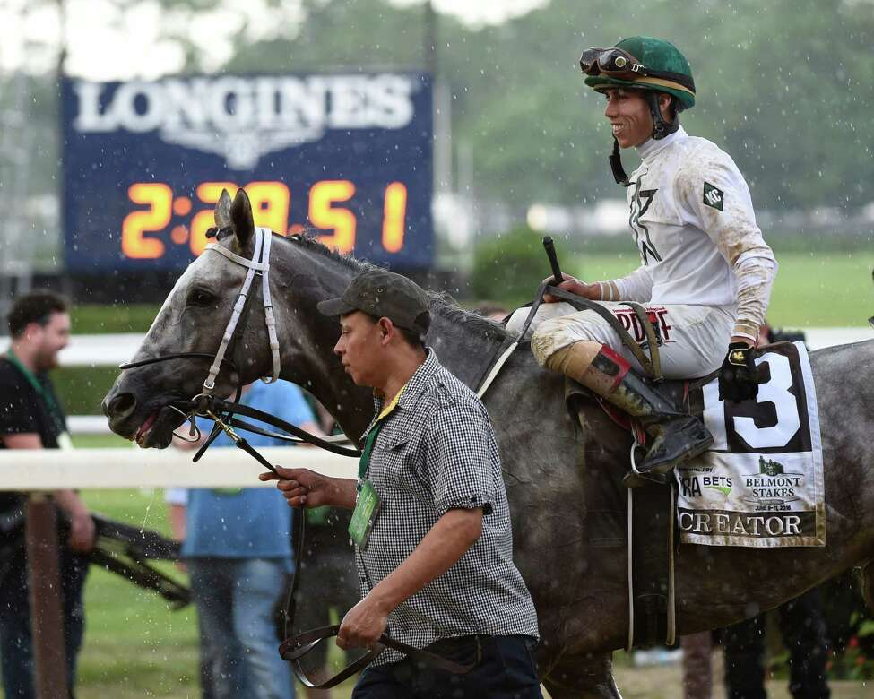 Jockey Irad Ortiz Jr.forgets the rain and is all smiles after winning the 148th running of The Belmont Stakes on Creator Saturday June 11, 2016 in Elmont, N.Y. (Skip Dickstein/Times Union)