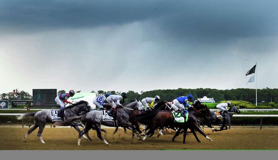 The field passes the clubhouse for the first time as rain breaks out in the 148th running of The Belmont Stakes on Creator Saturday June 11, 2016 in Elmont, N.Y. (Skip Dickstein/Times Union)