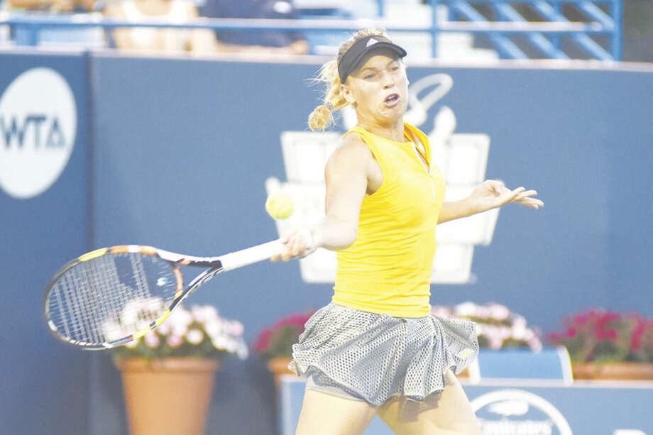 Hour photo/John NashCaroline Wozniacki of Denmark rips into a forehand return during her 6-0, 6-2 first-round victory over American Alison Riske during the Connecticut Open on Tuesday night at the Connecticut Tennis Center at Yale.