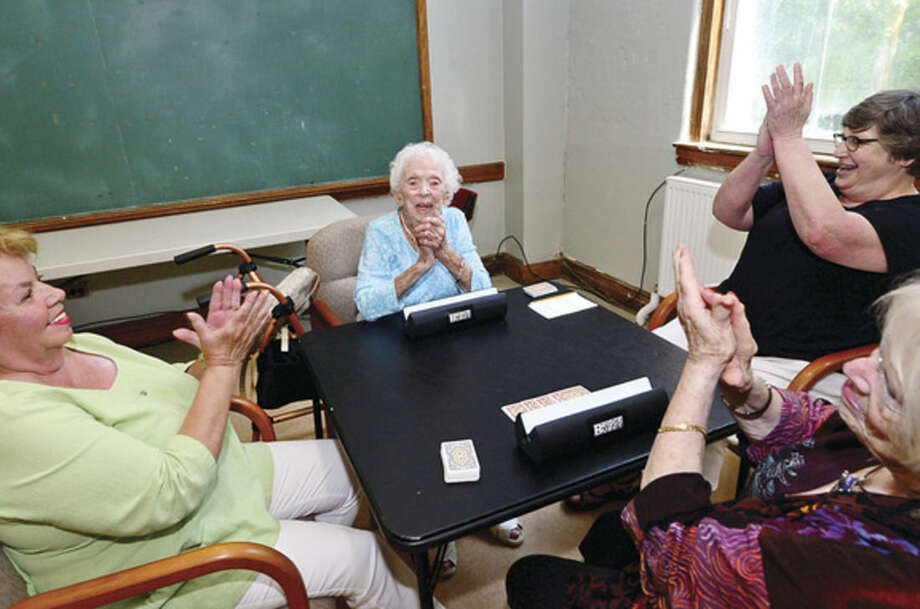 Hour photo / Erik Trautmann Doris Pollard, who plays bridge weekly at the Norwalk Senior Center, celebrates her 105th birthday with her card partners Mary Ann Capasso, Judy Barro, Susan Strand, and Center staff Tuesday.