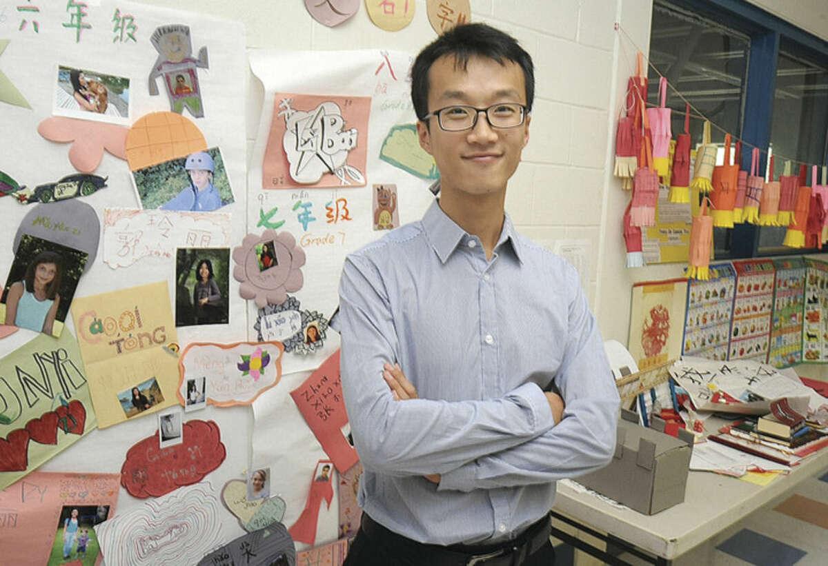 Hour photo/Matthew Vinci Long Li, a Chinese exchange teacher, who will teach Mandarin Chinese at Roton Middle School this school year.