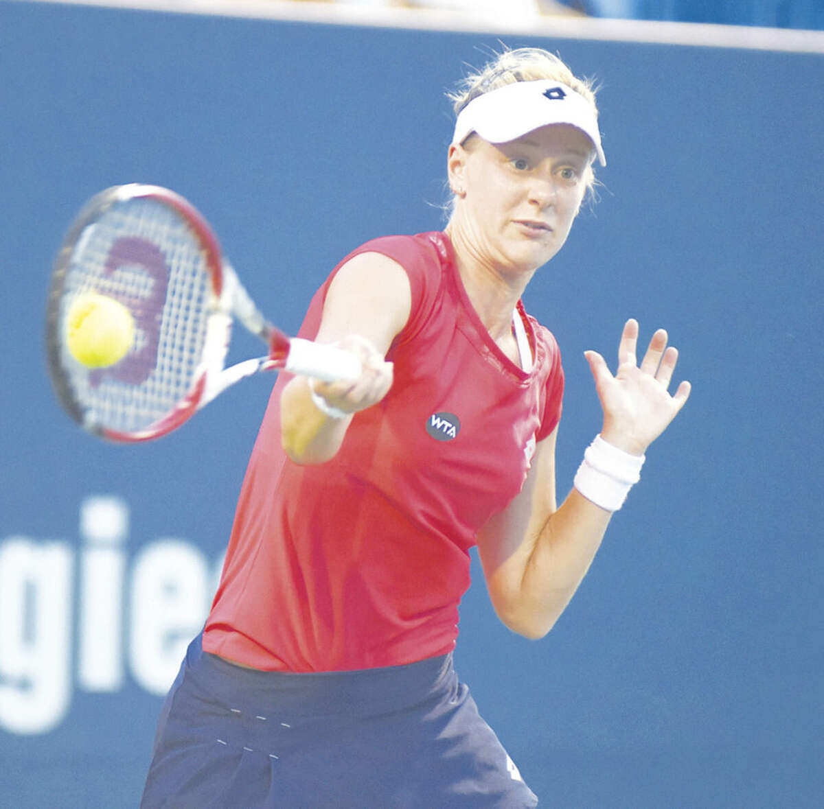 Hour photo/John Nash American tennis player Alison Riske hits a forehand return during her first round match against Caroline Wozniacki of Denmark on Tuesday night at the Connecticut Open in New Haven. Wozniacki coasted to a 6-0, 6-2 win.