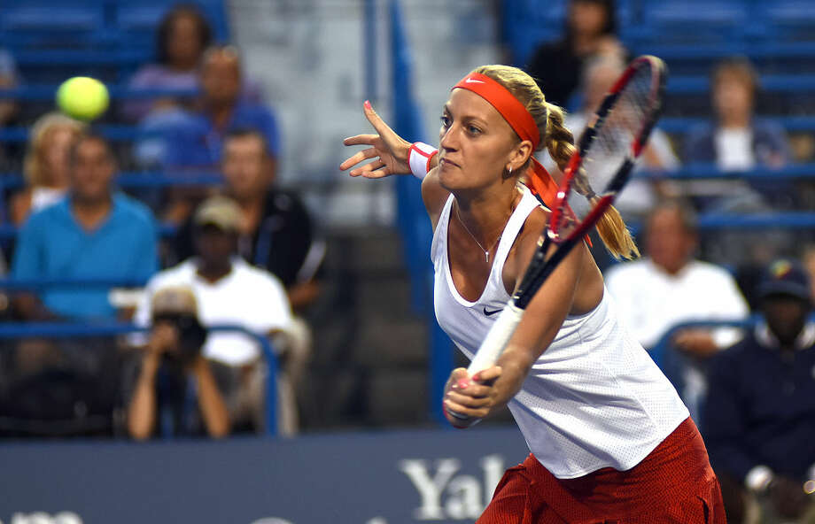 Hour photo/John Nash - Defending Connecticut Open champ Petra Kvitova keeps her eye on the ball as she approaches the net for a quick volley during her second round match against Madison Keys on Wednesday night in New Haven.