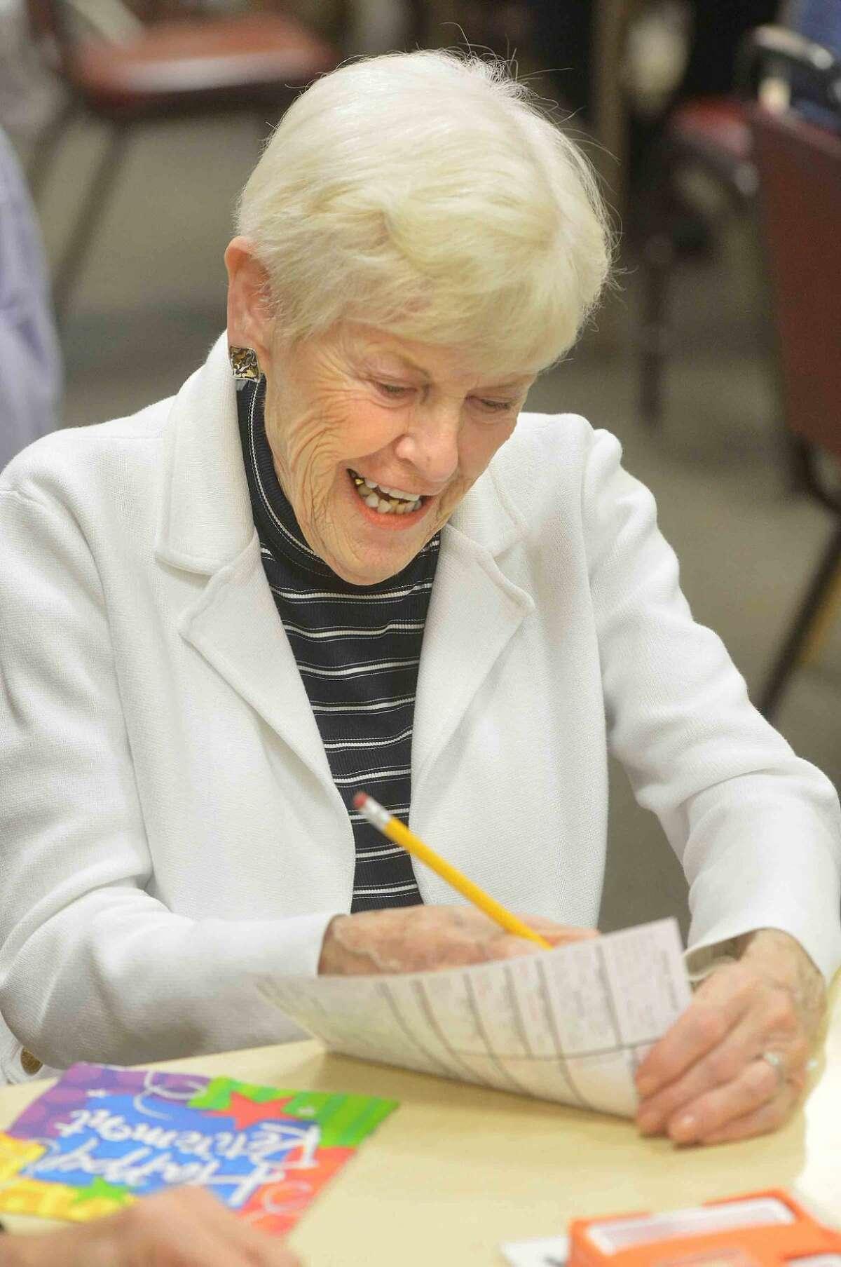 Hour Photo/Alex von Kleydorff Gail Schulze a longtime player writes down a score during the final session of The Wilton Bridge Studio on Wednesday