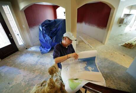 Greg Bowen's home in the Stable Gate subdivision off Telge Road in Cypess has been stripped to the drywall and of flooring after filling with water April 18, the first time the development ever flooded.