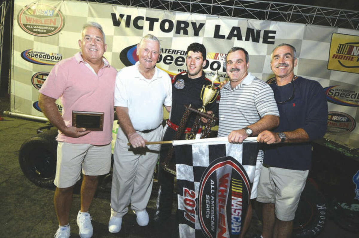Hour Photo/Alex von Kleydorff Chuck, Jimmy and Dennis Mitchell join Don Lajoie, second from left, and car No. 88 winner Keith Rocco, center, in Victory Lane after the SK Modifieds Charlie Mitchell Memorial Race at Waterford Speed Bowl on Saturday night.