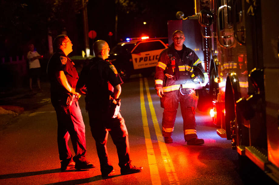 Hour photo/Chris Palermo. Norwalk Fire and Police respond to a kitchen fire on Pine Hill Ave. Thursday night.