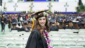 A graduate smiles after receiving her diploma during the University of Washington's 141st Annual Commencement Exercises, at Husky Stadium, Saturday, June 11, 2016.