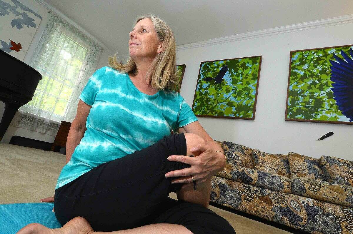 Brooke Stewart in a spinal twist at her Milestone Yoga studio in Wilton.