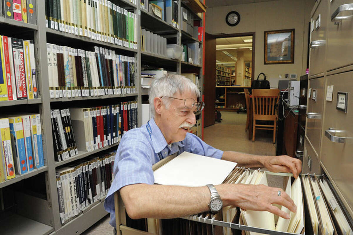 Paul Keroack with the Norwalk Public Library looks for local information from World War I in the archives of the Norwalk history room.Hour photo/Matthew Vinci
