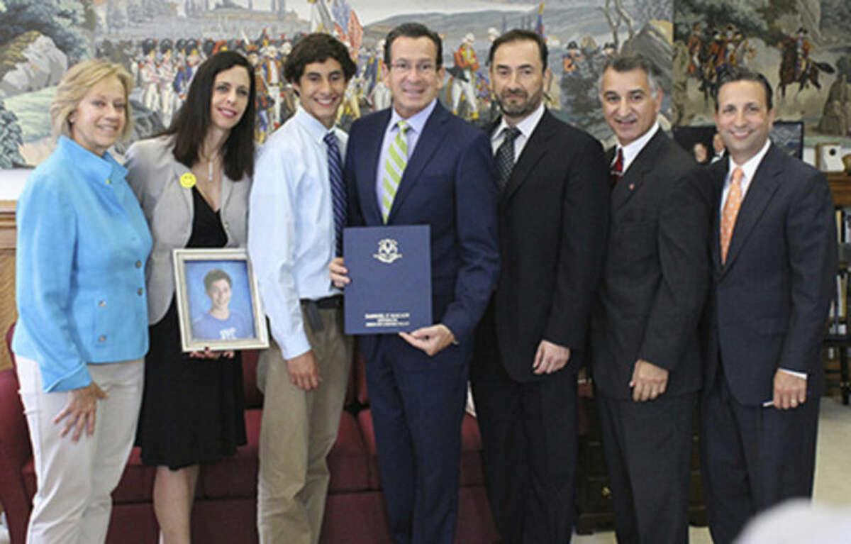 Contributed photo From left: State Rep. Terrie Wood, R-141; Giovanna Peña, Caesar Peña, Gov. Dannel Malloy, Victor Peña, Sen. Carlo Leone, D-27; and Sen. Bob Duff, D-25.